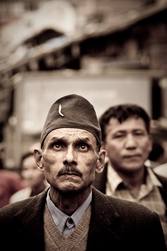Man listening to speeches on communist gathering in India